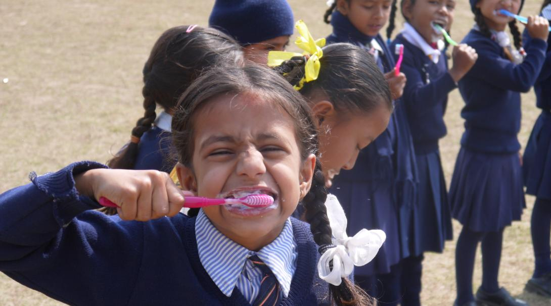 Projects Abroad volunteers work with children in Nepal and teach them the importance of brushing their teeth.